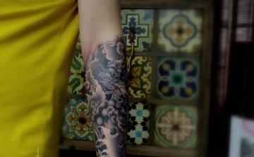柳州纹身阿里纹身出品:唐狮