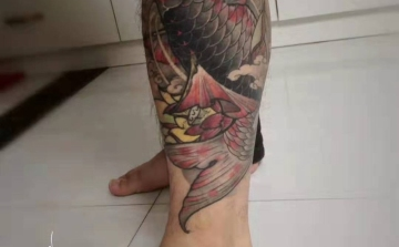 柳州纹身阿里纹身作品——花腿
