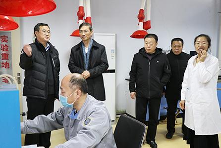 省市场监督管理局党组副书记、局长金洪钧到我院调研