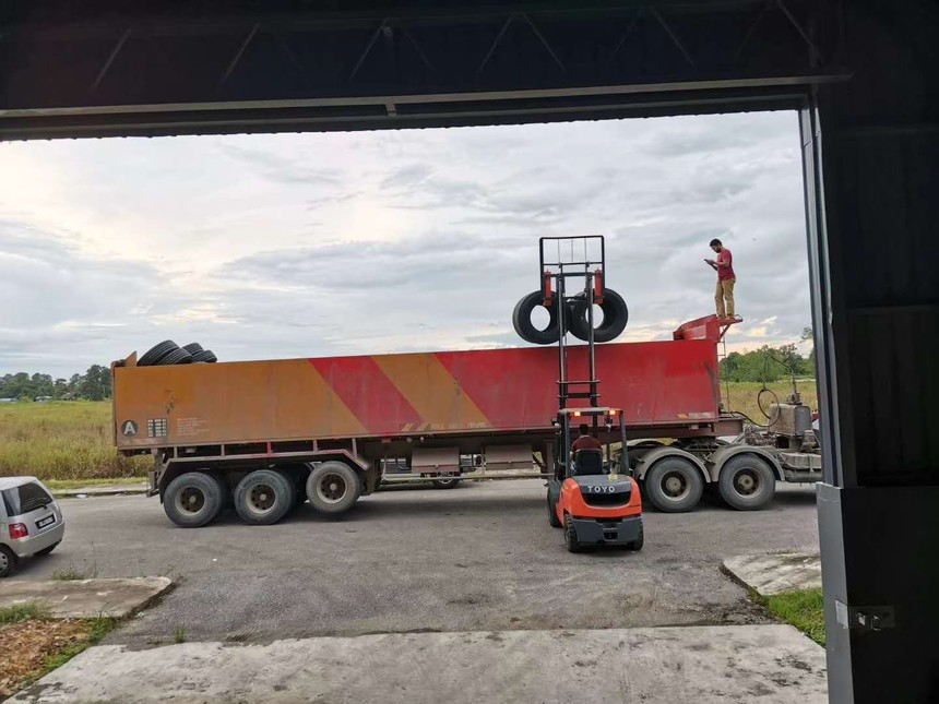 A large truck loads HuaanTire